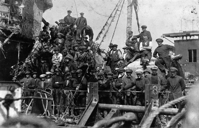 image of a shipwreck being raised with lots of men standing on deck