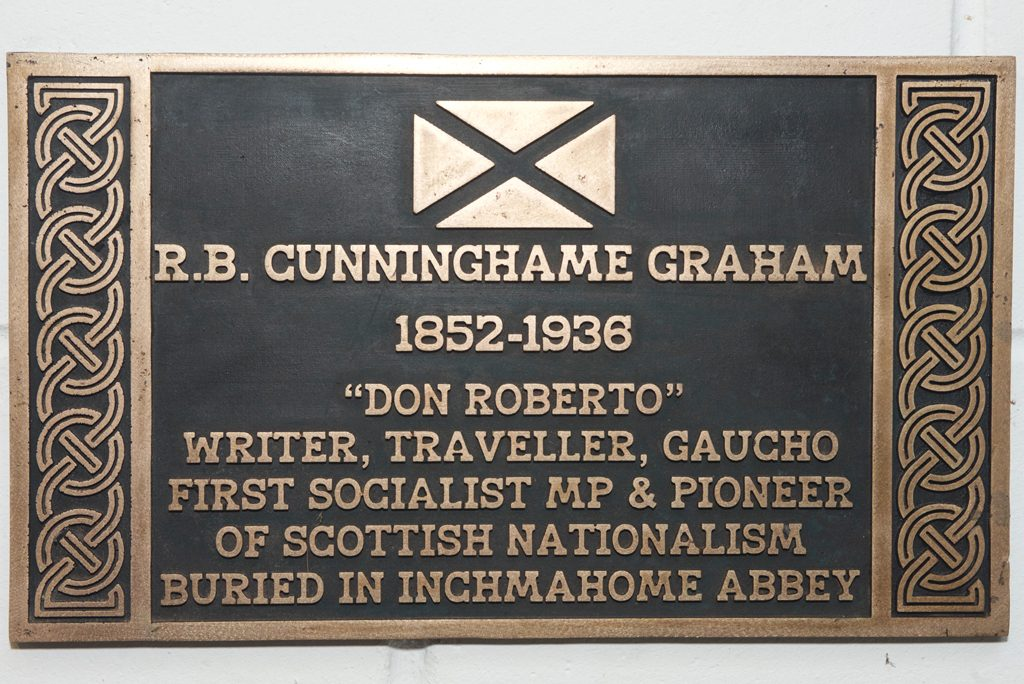 brown and gold plaque with a message commemorating R.B.Cunninghame Graham