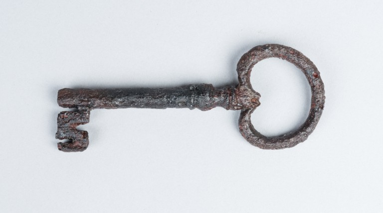 old key lying on a white background