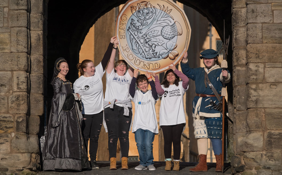 Image of a group of young people launching £1 entry offer to historic sites