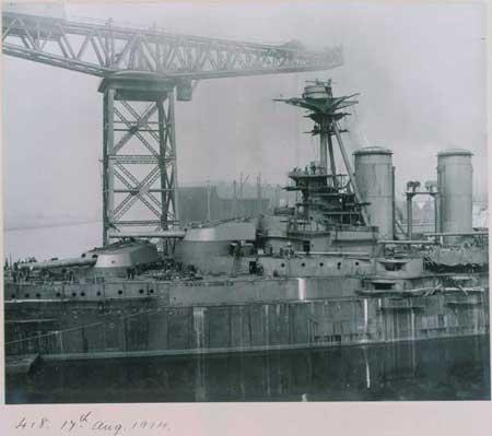 steam ship beside a crane