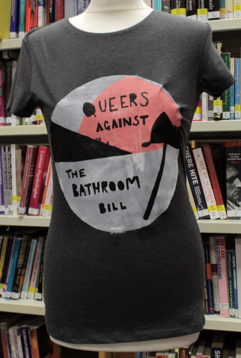 grey t-shirt with slogan reading queers against the bathroom bill