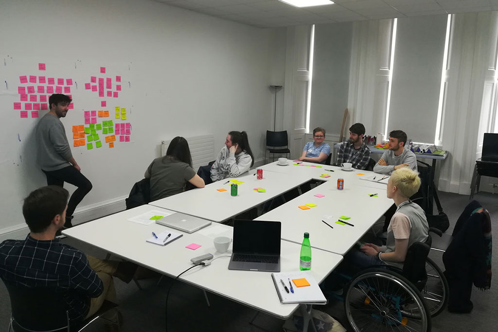 Image of a group of young people participating in an ideas workshop