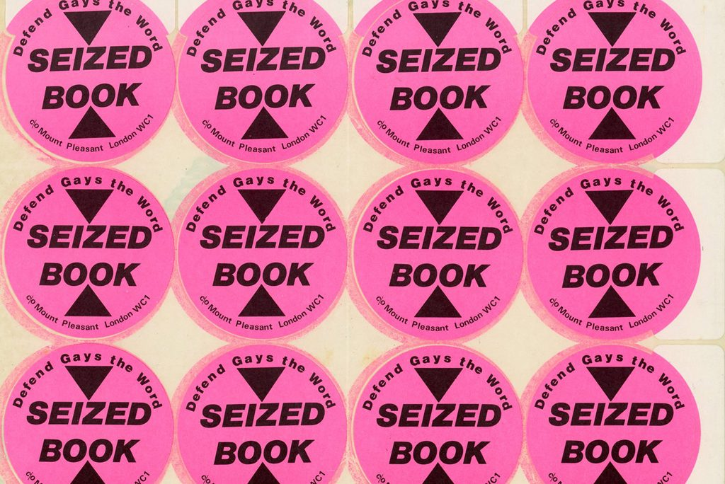 three horizontal rows of round pink stickers