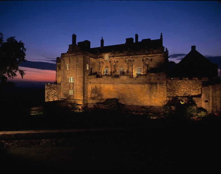 castle lit up at night