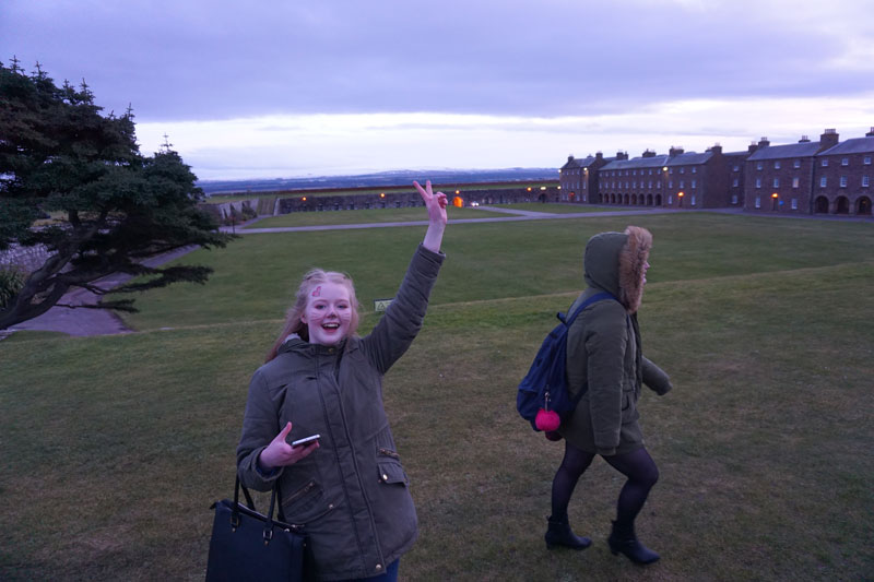 Image of two young people enjoying a trip to Fort George on Care Day 2018.