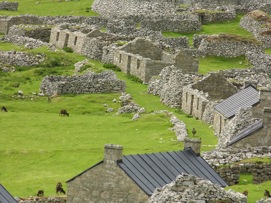 a row of stone cottages with no roofs