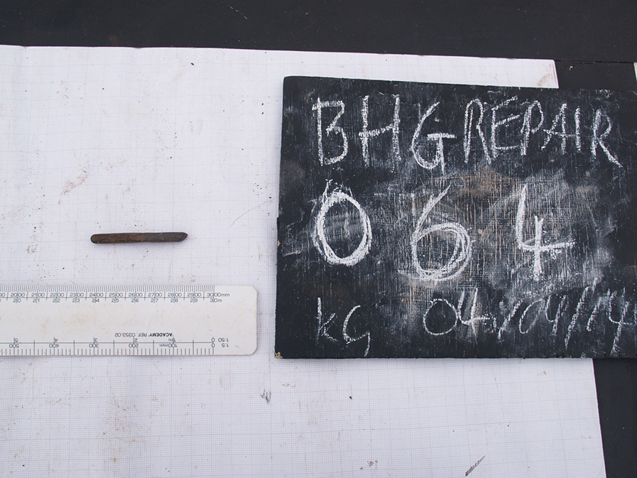 Small rectangular object beside a blackboard