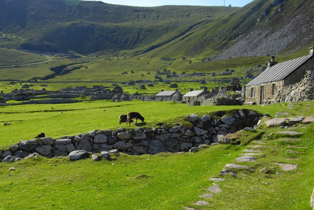 green valley with grazing animals and stone cottages - Image © Kevin Grant