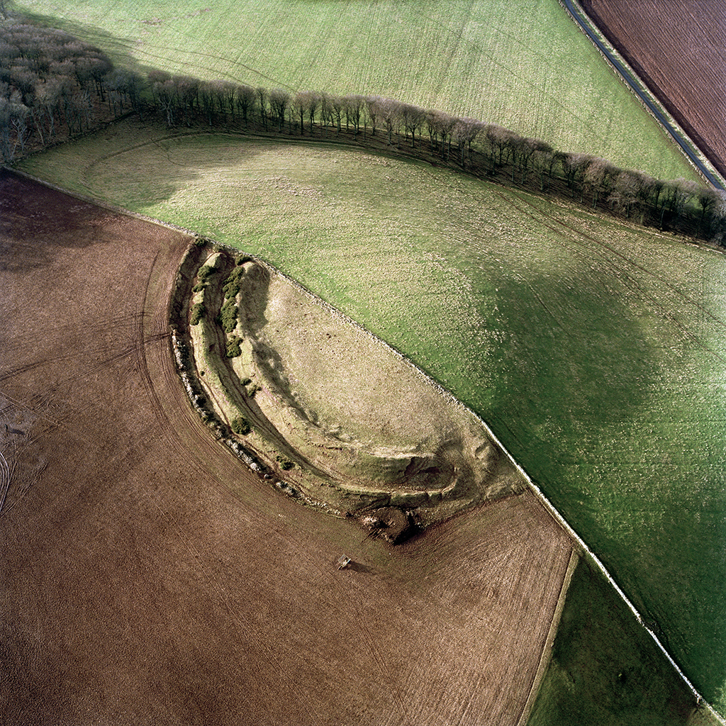 view from above showing mound of earth half covered in grass