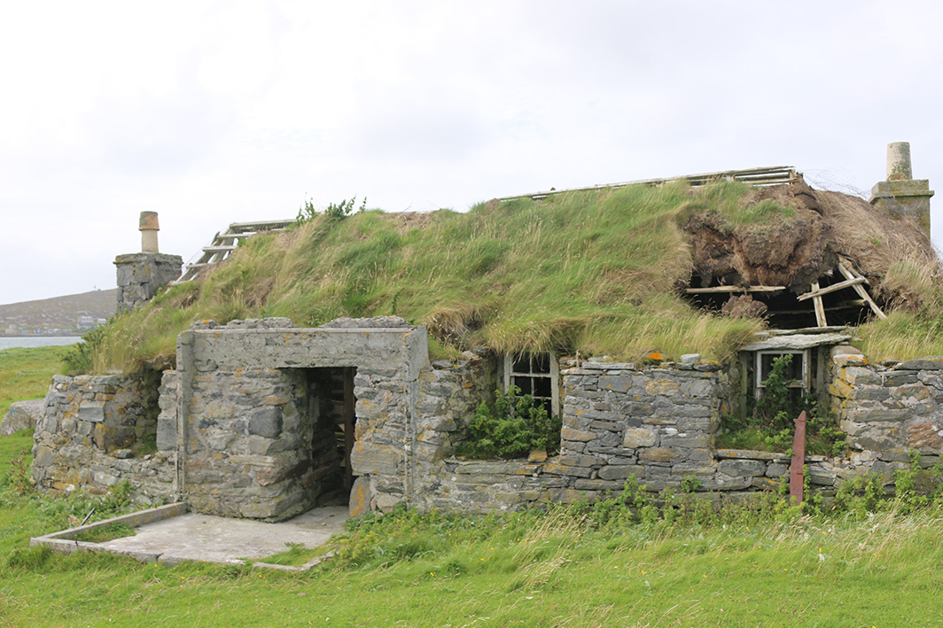 ruined cottage with grass roof
