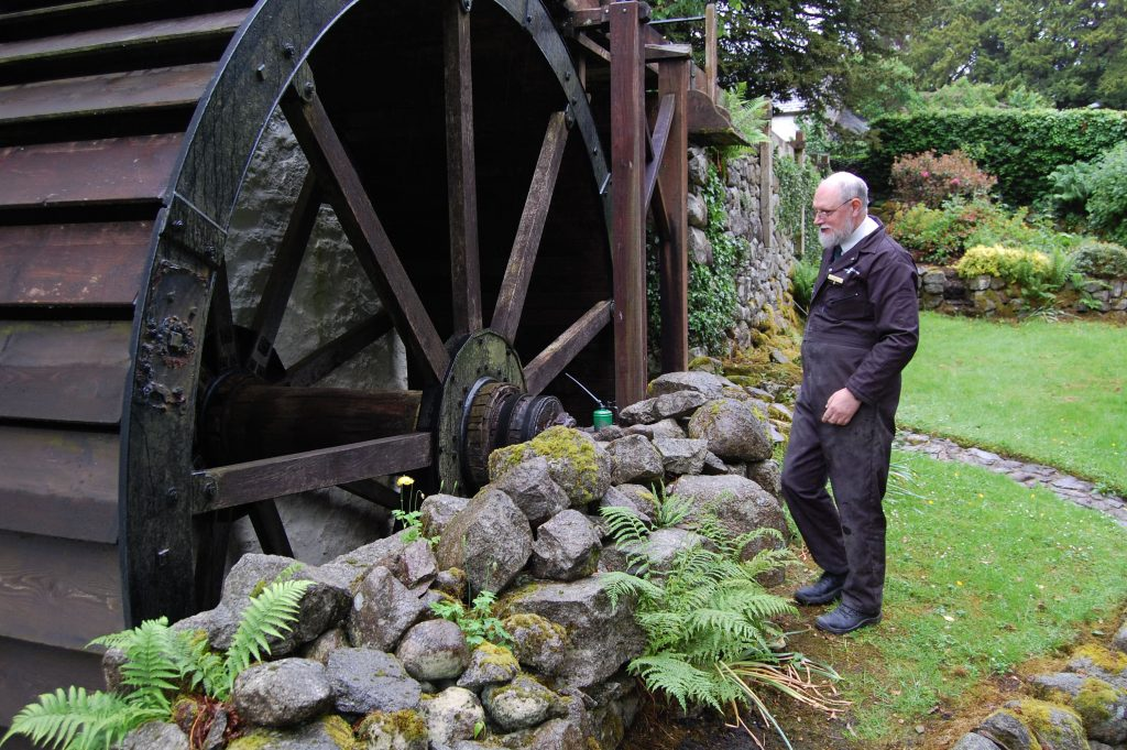 George Hering with the New Abbey Corn Mill water wheel