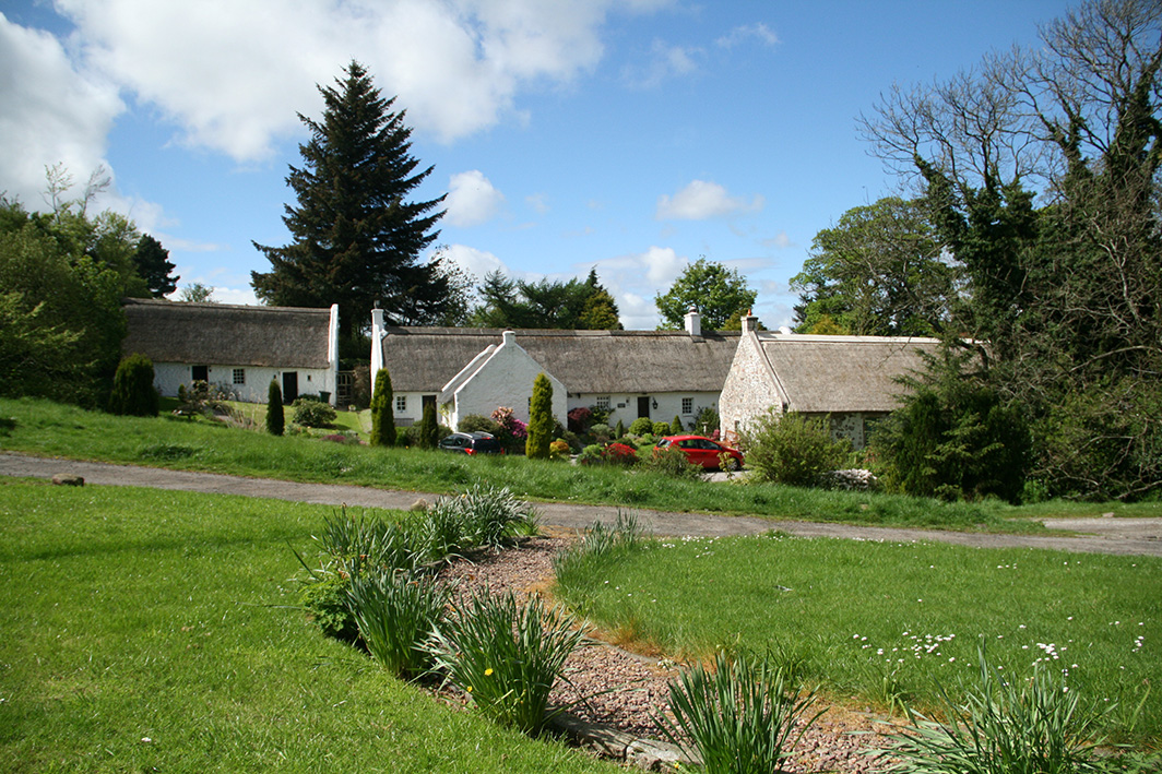 three thatched cottages