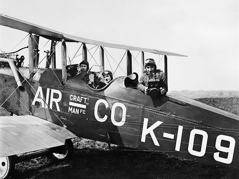 Photo showing young men in a biplane