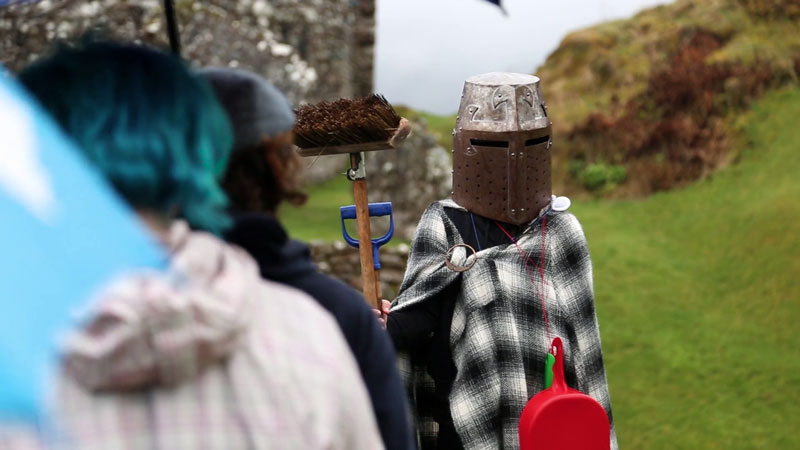Image of a group of young people performing in a play at Urquhart Castle