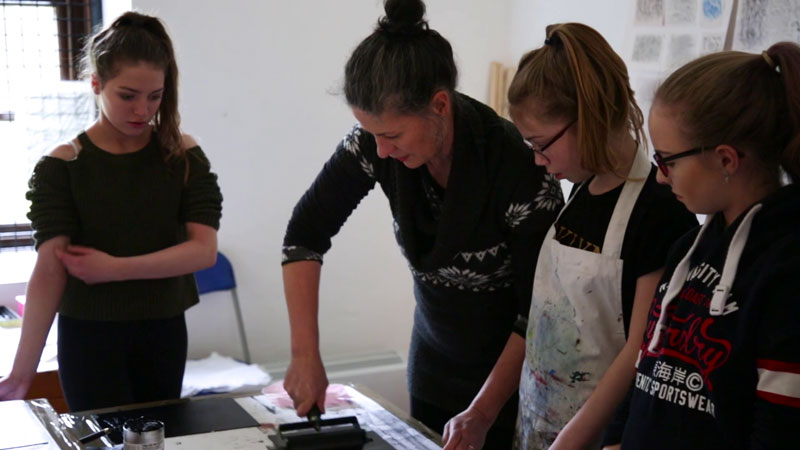 Image of a group of young people learning printmaking with the Highland Youth Arts Hub