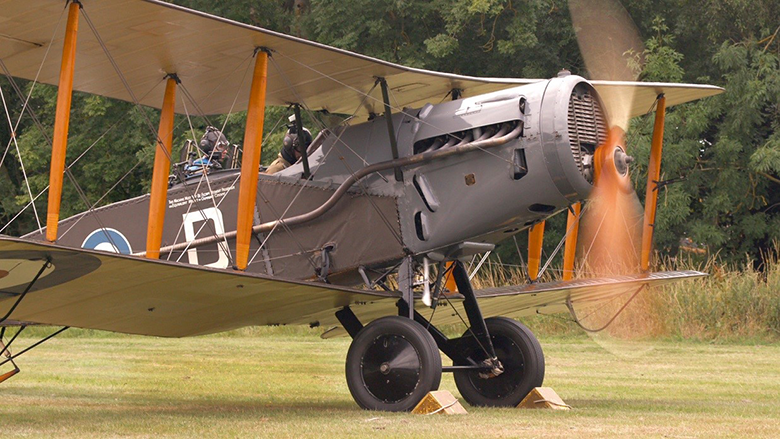 A Bristol Fighter in a field with propeller spinning