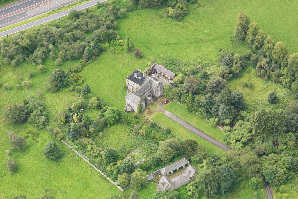 view from above showing house and estate near a main road