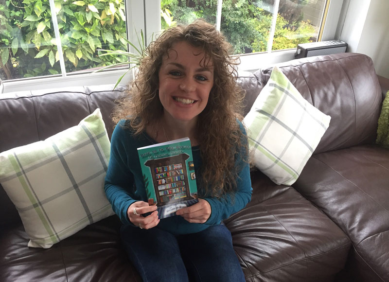 Author Megan Murray holds her self published book 'Maggie and the Magic Bookcase'