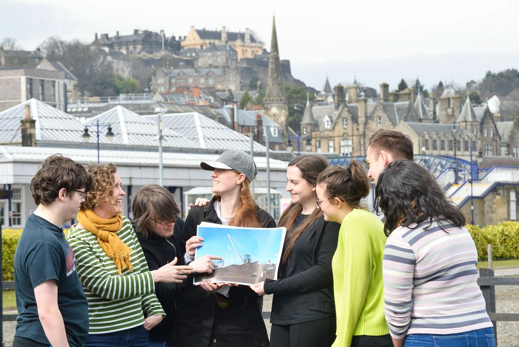 Image of a group of people embarking on a heritage trail against the backdrop of Stirling town centre