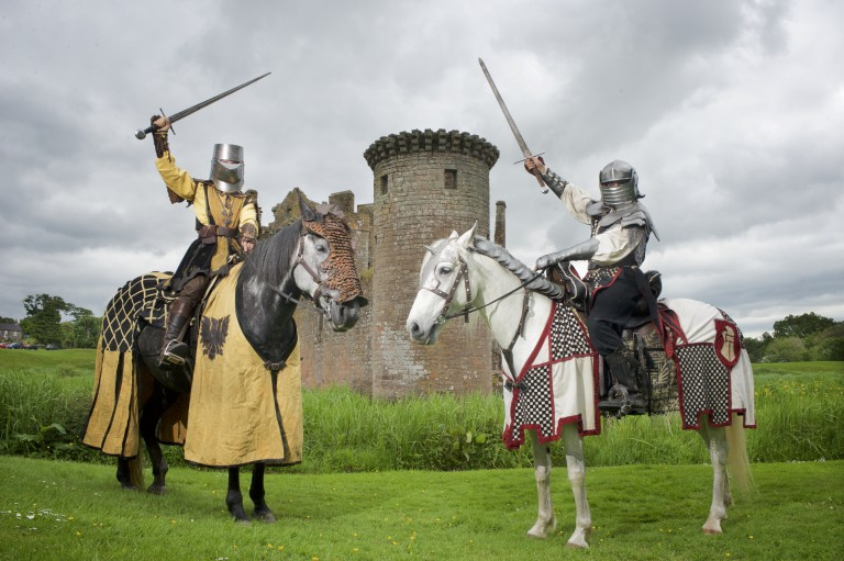 two knights on horseback face each other