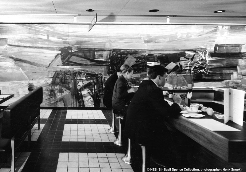 Visitors dine at Glasgow Airport's cafeteria with a large mural in the background