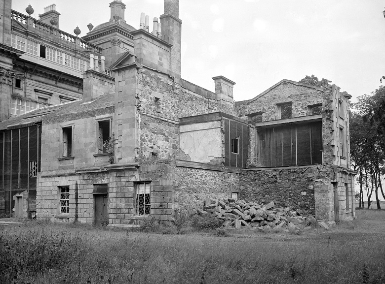 side view of a large building partly demolished