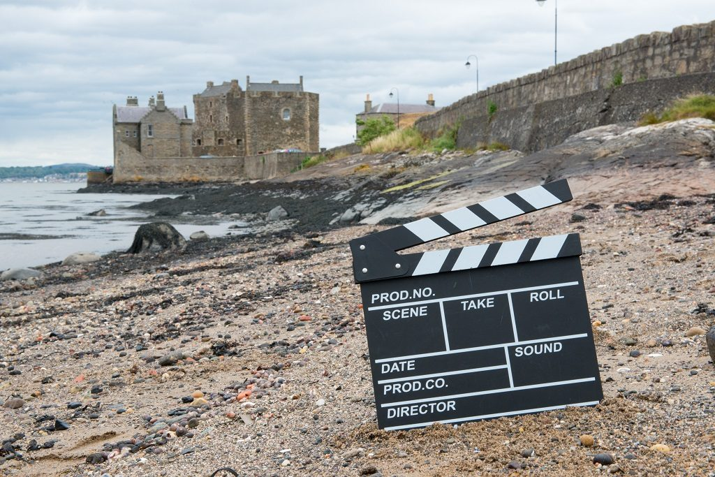 View of Blackness Castle with a clapper board in the foreground