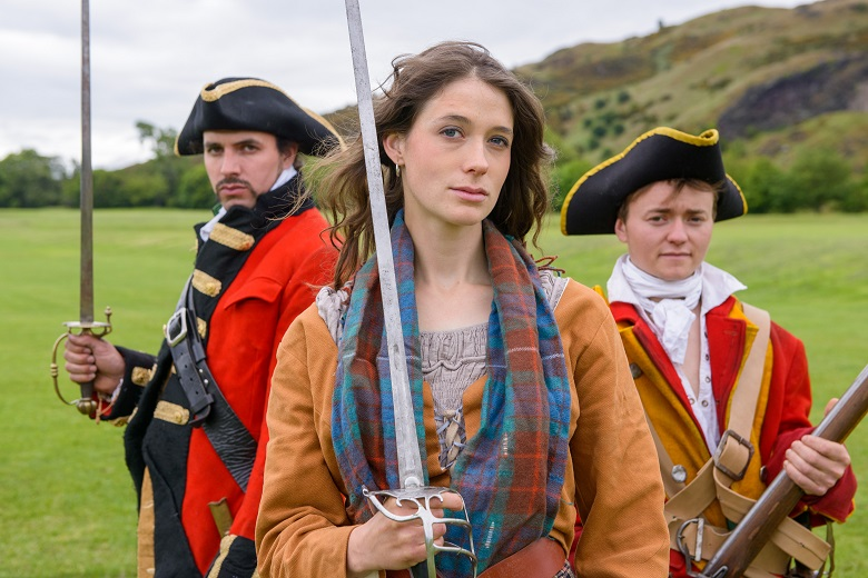 Female Covenanter flanked by two redcoats