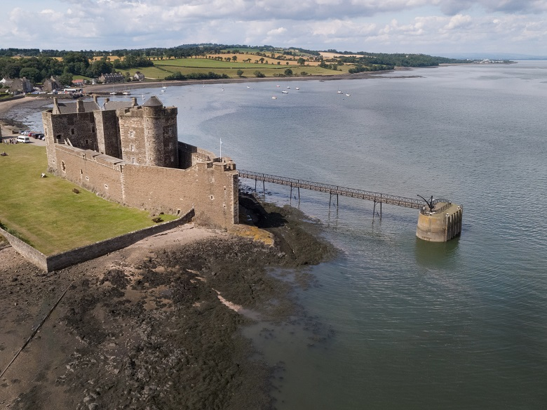 Aerial photo of Blackness Castle, one of Historic Scotland's popular filming locations