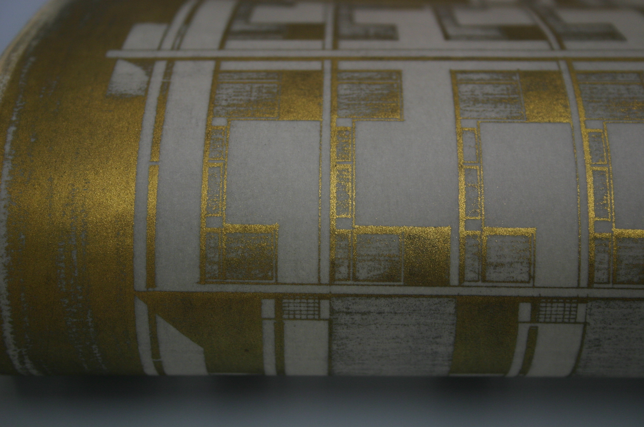 Gold detail which appears on the back of an architect's plan