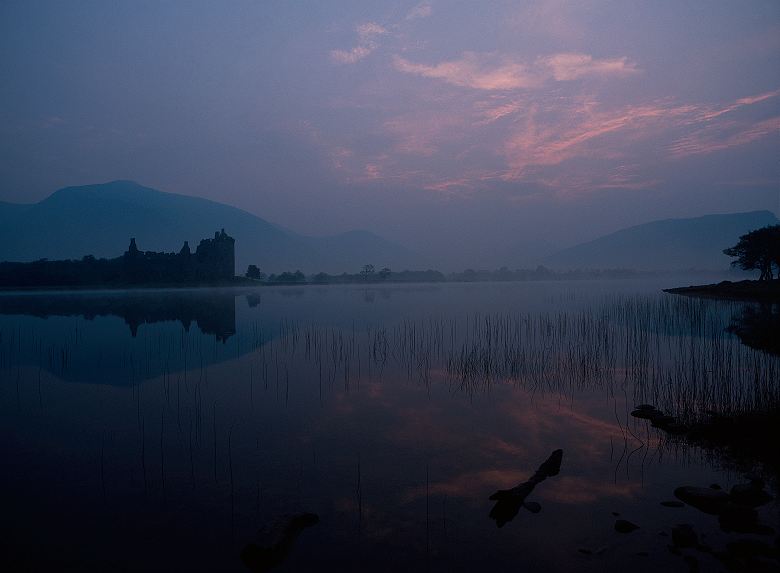 View of Kilchurn Castle across Loch Awe at twilight