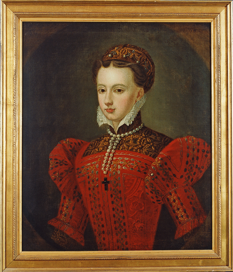 A portrait of Mary Queen of Scots. She is young, wearing an ornate red dress with a white collar. She is wearing a necklace containing a black crucifix.