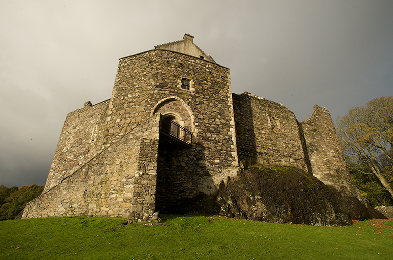 low angled view of Dunstaffnage Castle with a glowering sky