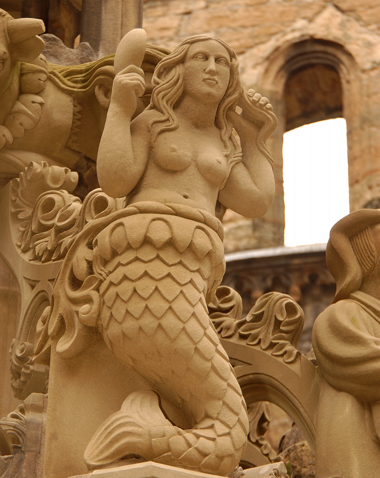 carving of a mermaid on the Linlithgow fountain. She looks in a mirror