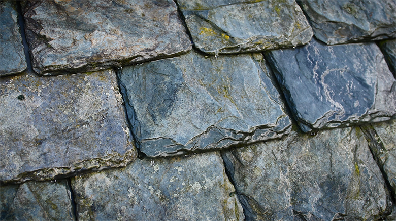 A close up shot of a traditional slate roof
