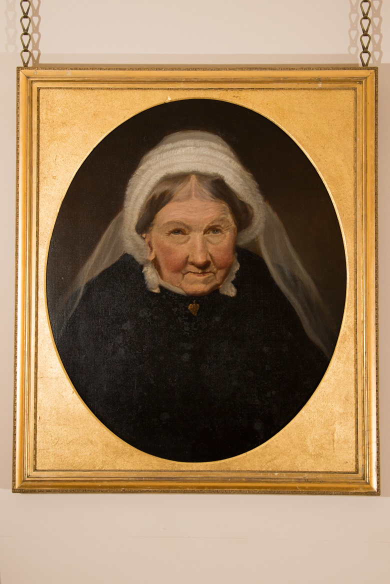 A portrait of an old woman wearing a black outfit with a white veil which hangs at Duff House