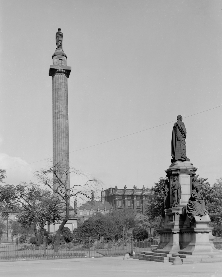 A massvie column with a statue on top in the middle of Charlotte Square, Edinburgh