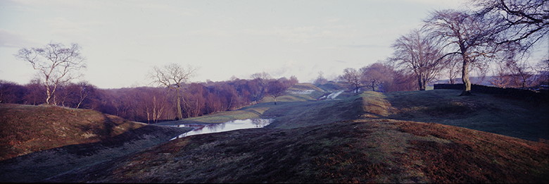 Panoramic view of Scottish countryside where the mounds of the Antonine Wall can be clearly seen