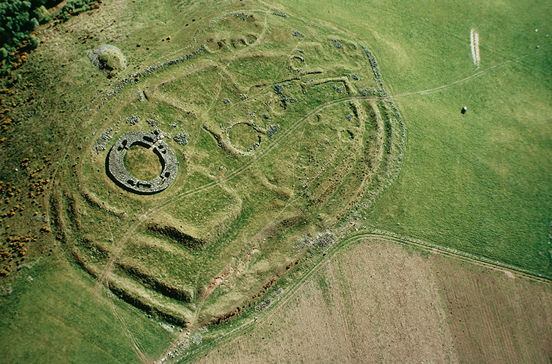 Aerial view of this unusual complex showing impressive double ramparts and other features