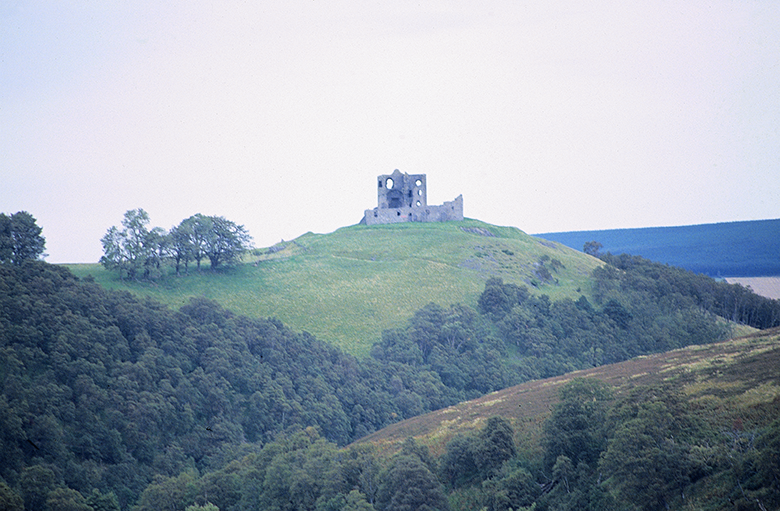 View of Auchindoun Castle perched on a hill