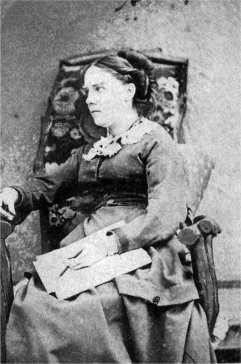 A photograph of a lady in a chair