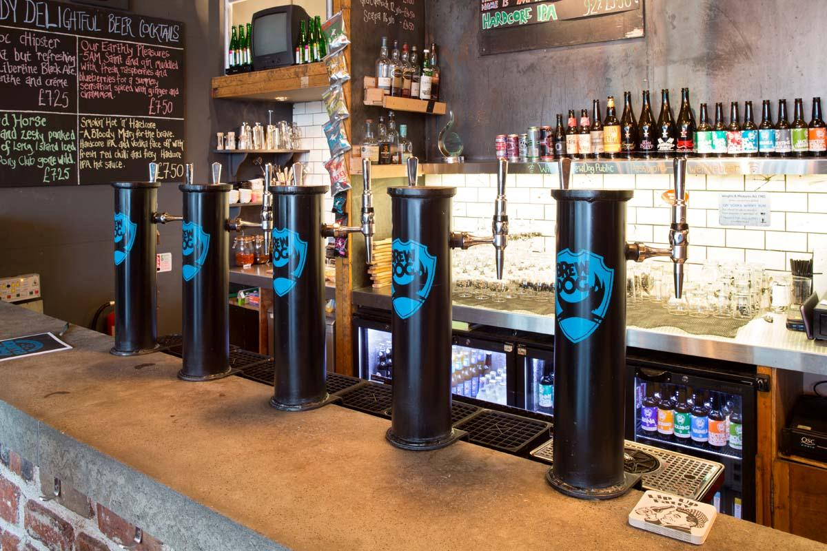 A Brewdog bar with five beer taps.
