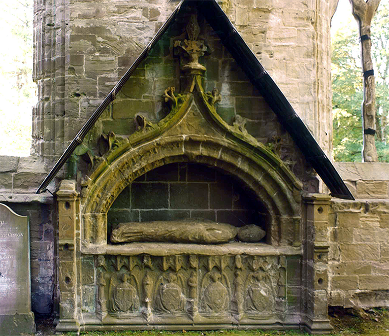 Bishop Cardeny's wall tomb. A stone tomb built into the wall of the cathedral with intricate stone carvings under an arch.