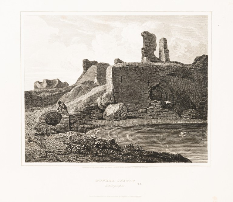 An engraving showing a ruined castle overlooking a beach. A solitary figure can be seen exploring the ruins.