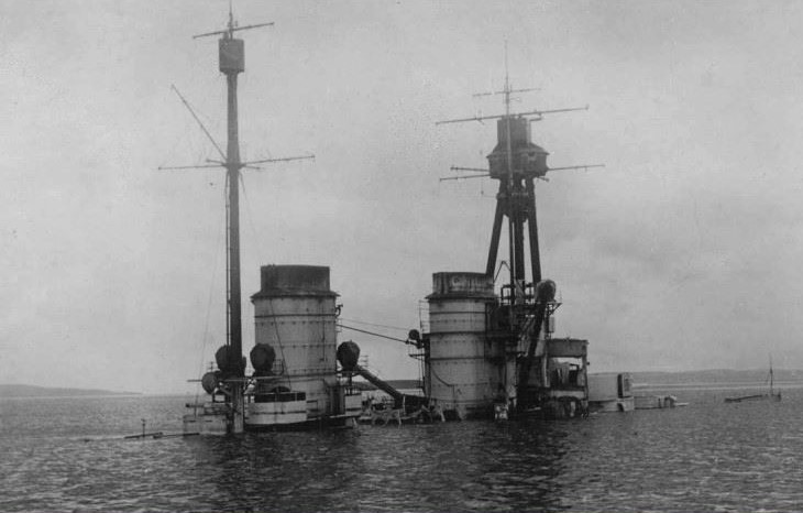 Archive image of a First World War ship sinking in Scapa Flow
