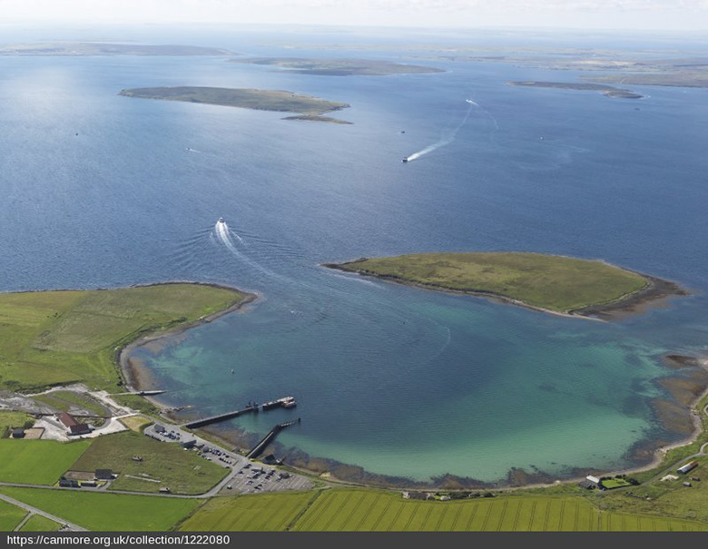 An aerial photo of Scapa Flow showing its expansive waters sheltered by small islands