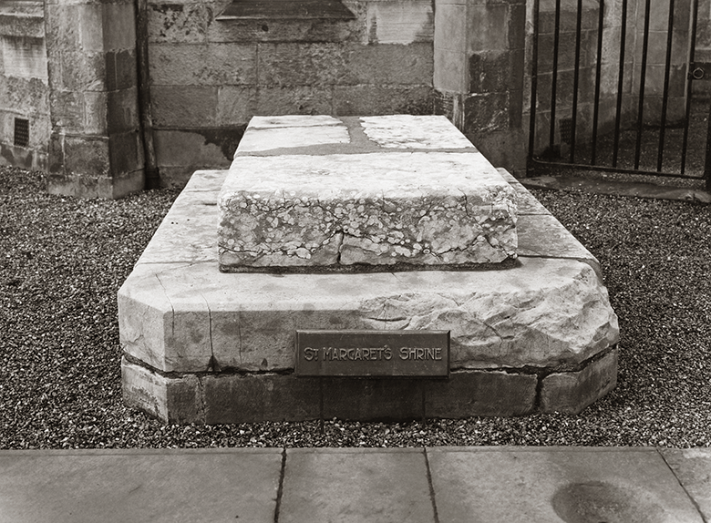 Two large slabs atop each other - the remains of a shrine in the ruins of Dunfermline Abbey.