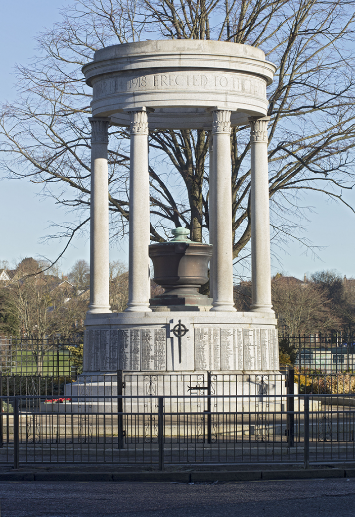grey granite classical colonnaded style memorial with circular stepped plinth and central copper urn