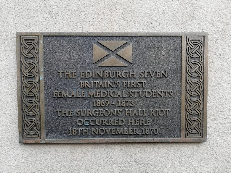 Plaque reading: The Edinburgh Seven. Britain's first female medical students. 1869-1873. THe Surgeons' Hall Riot occurred here 18th November 1870
